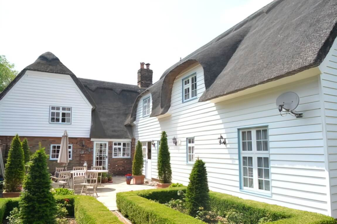 Renovation and painting of windows and cladding in a grade 2 listed cottage in Barley