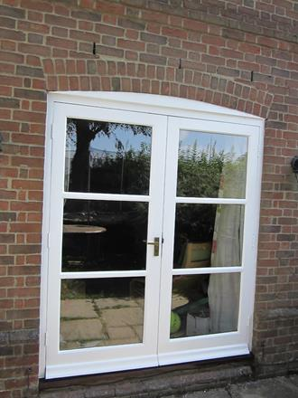 Repairing and painting windows in Reed