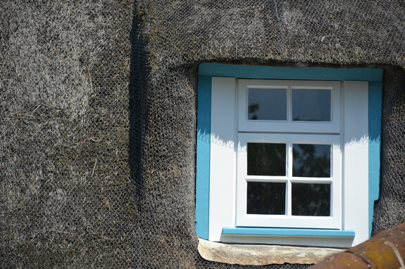 thatched roof cottage window