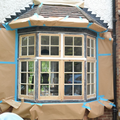 Surrounding areas are protected with heavy duty masking paper and film.