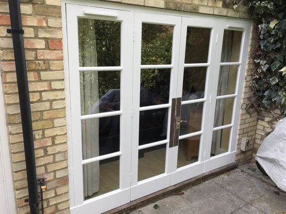 Renovation of old wooden windows in a Victorian house in Cambridge