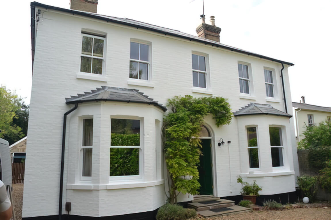 Repairs to sash windows and painting of masonry walls in a beautiful house in Great Shelford, Cambridge