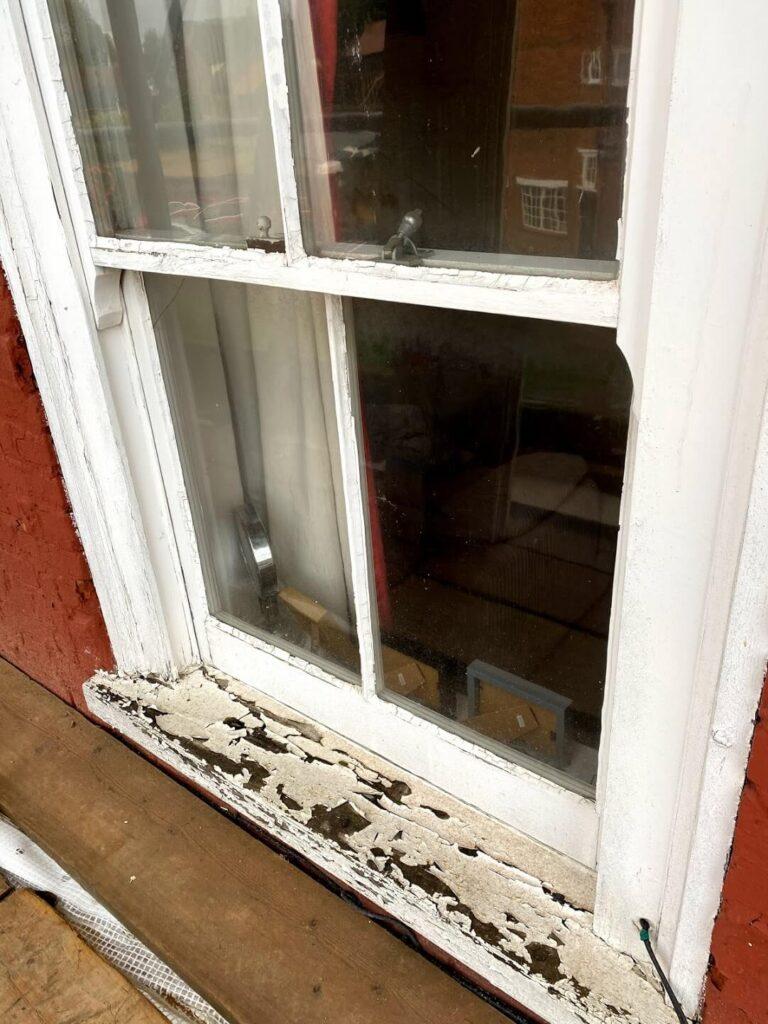 Flaking paint on window sills