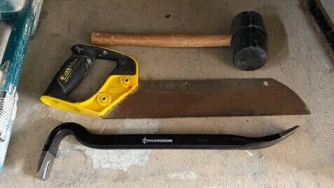 Сrowbar, hammer and hand saw