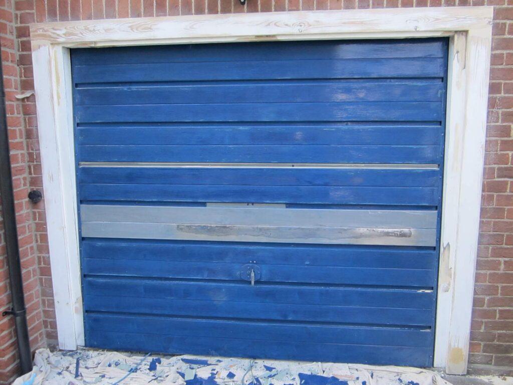 Remove old paint from the metal garage door
