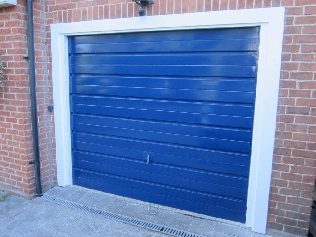 Priming and painting the garage door