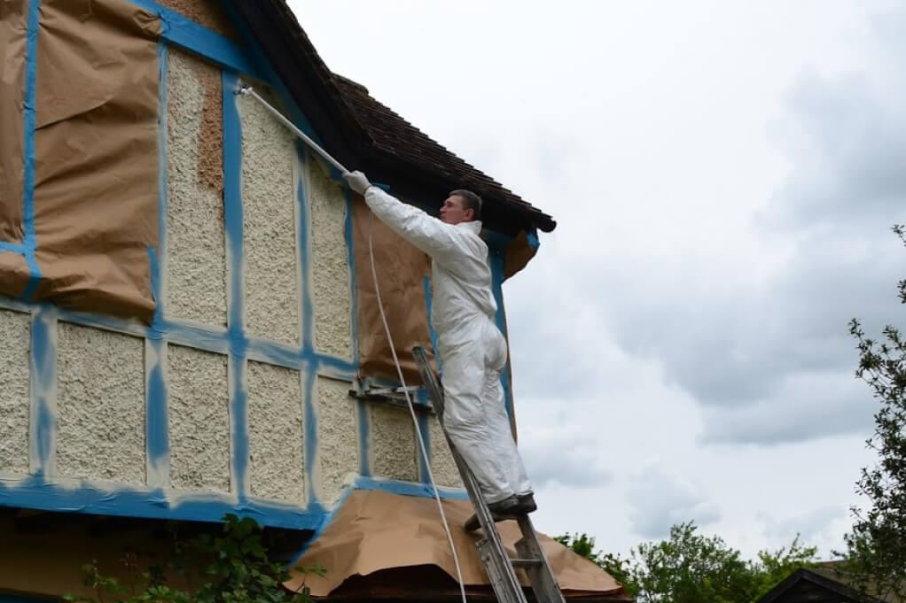 spraying masonry paint process
