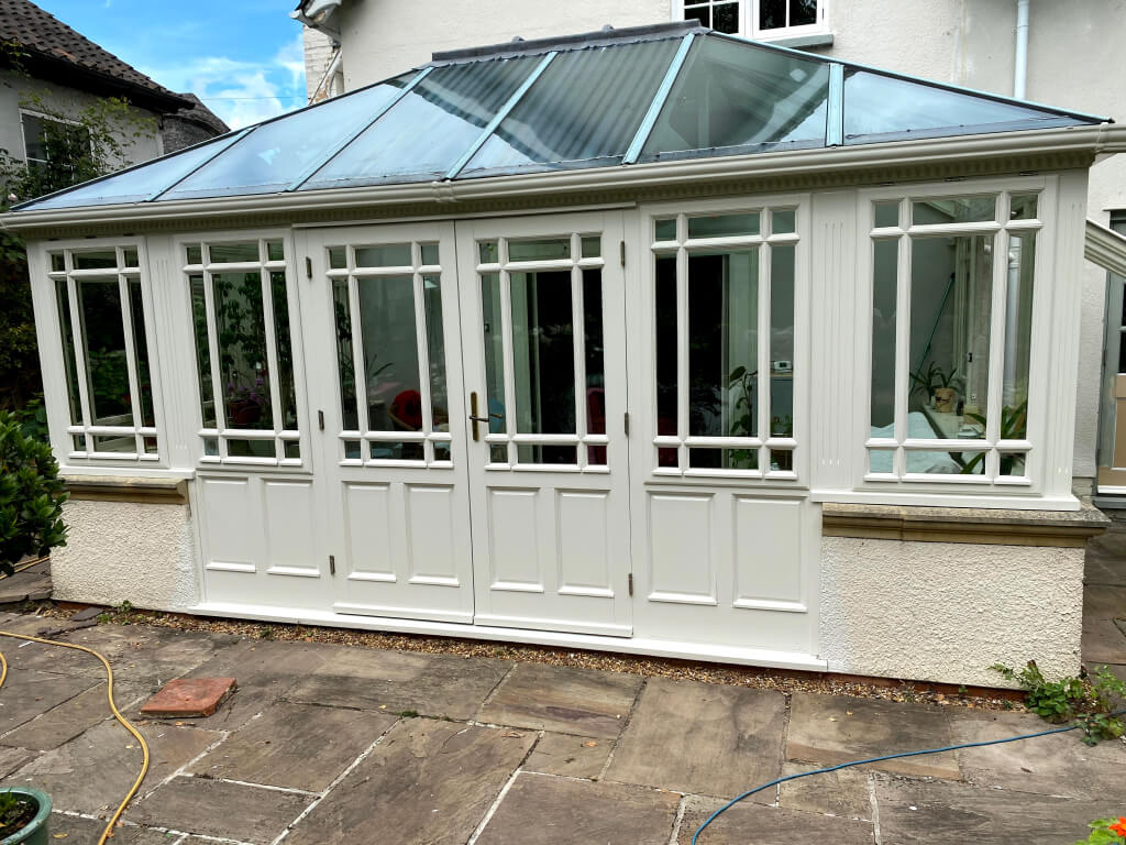 freshly re-decorated conservatory with set of French doors